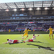 Hector Jimenez , (centre), Columbis Crew, is challenged by Eric Alexander, (left) and Roy Miller, New York Red Bulls, during the New York Red Bulls Vs Columbus Crew, Major League Soccer regular season match at Red Bull Arena, Harrison, New Jersey. USA. 19th October 2014. Photo Tim Clayton