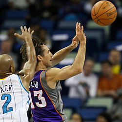 February 2, 2012; New Orleans, LA, USA; Phoenix Suns point guard Steve Nash (13) passes as New Orleans Hornets point guard Jarrett Jack (2) defends during a game at the New Orleans Arena. The Suns defeated the Hornets 120-103.  Mandatory Credit: Derick E. Hingle-US PRESSWIRE