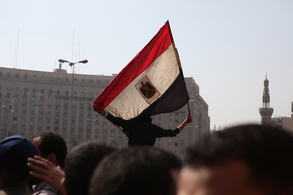 A protester holds an Egyptian flag at Tahrir Square.