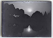 glass plate with lake and trees night view and moon