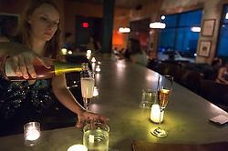 Mina Gaber pouring glasses of Charles Bove sparkling Cabernet Franc/Gamay Rosé at 13 Celsius.