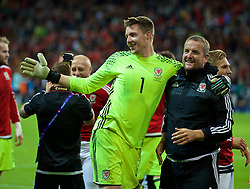 LILLE, FRANCE - Friday, July 1, 2016: Wales' goalkeeper Wayne Hennessey and goalkeeping coach Martyn Margetson celebrates after a 3-1 victory over Belgium and reaching the Semi-Final during the UEFA Euro 2016 Championship Quarter-Final match at the Stade Pierre Mauroy. (Pic by David Rawcliffe/Propaganda)
