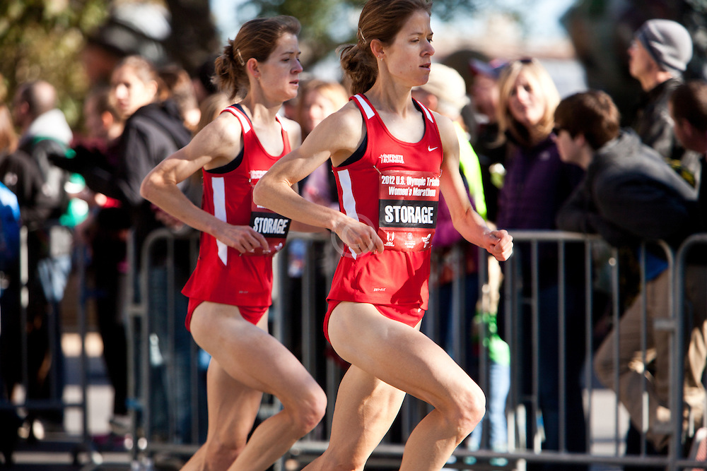 Tara and Kara Storage, twins, with quarter mile to go in women's marathon