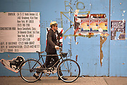 Hipster with his bike walking on a street of the Meatpacking District in Manhattan, New York, 2010.
