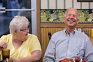 Vice President Joe Biden laughts with a patron during an unannounced stop at the Good Earth Restaurant during a two-day campaign swing through Iowa on Monday, September 17, 2012 in Muscatine, IA.