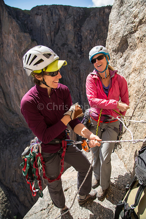 "Big wall climbers Madaleine Sorkin and Kate Rutherford giving one another support during an ascent of the ""Free Nose,"" rated 12c, in the Black Canyon of the Gunnison."