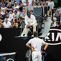 Roger Federer of Switzerland and a chair umpire on day ten of the 2018 Australian Open in Melbourne Australia on Wednesday January 24, 2018.<br /> (Ben Solomon/Tennis Australia)