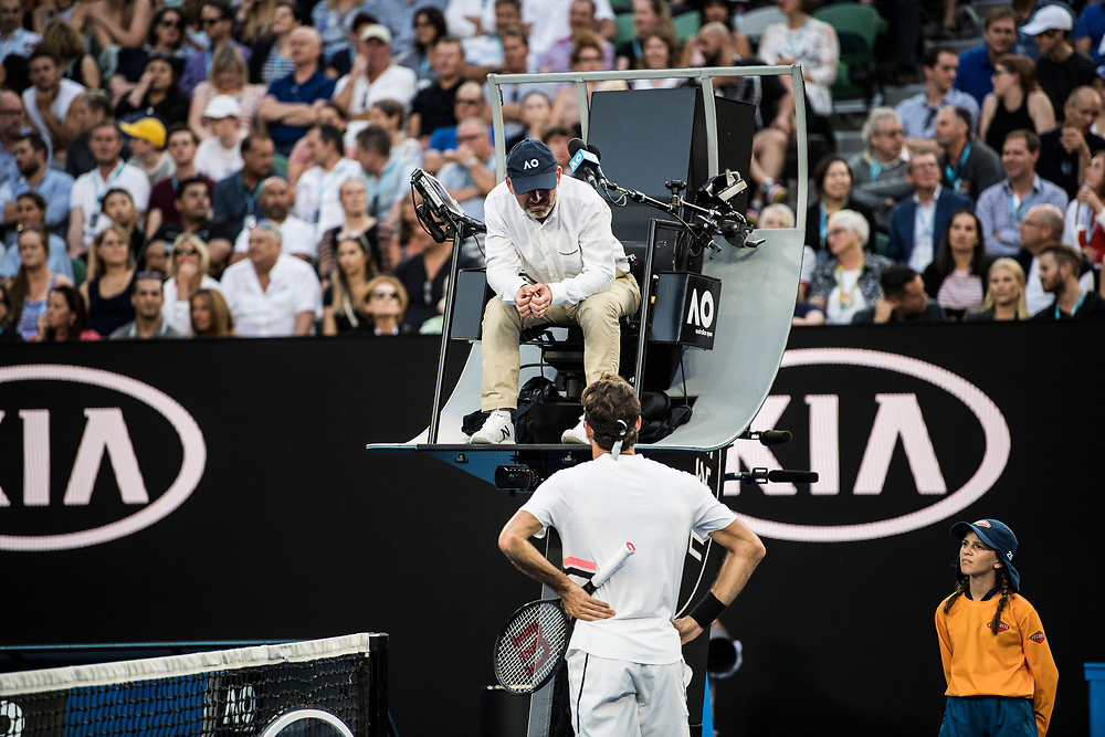 Roger Federer of Switzerland and a chair umpire on day ten of the 2018 Australian Open in Melbourne Australia on Wednesday January 24, 2018.<br /> (Ben Solomon/Tennis Australia)