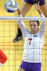 06 November 2010: Emily Wandersee attacks with a light touch during an NCAA volleyball match between the Purple Aces of the University of Evansville and the Illinois State Redbirds at Redbird Arena in Normal Illinois.