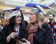 Airtran employees Roxi Miklovik (left) & Judith Brown wear Southwest Airlines inflatable plane hat during a news conference officially celebrating the launch of airline's operations at Hartsfield-Jackson International Airport in Atlanta.
