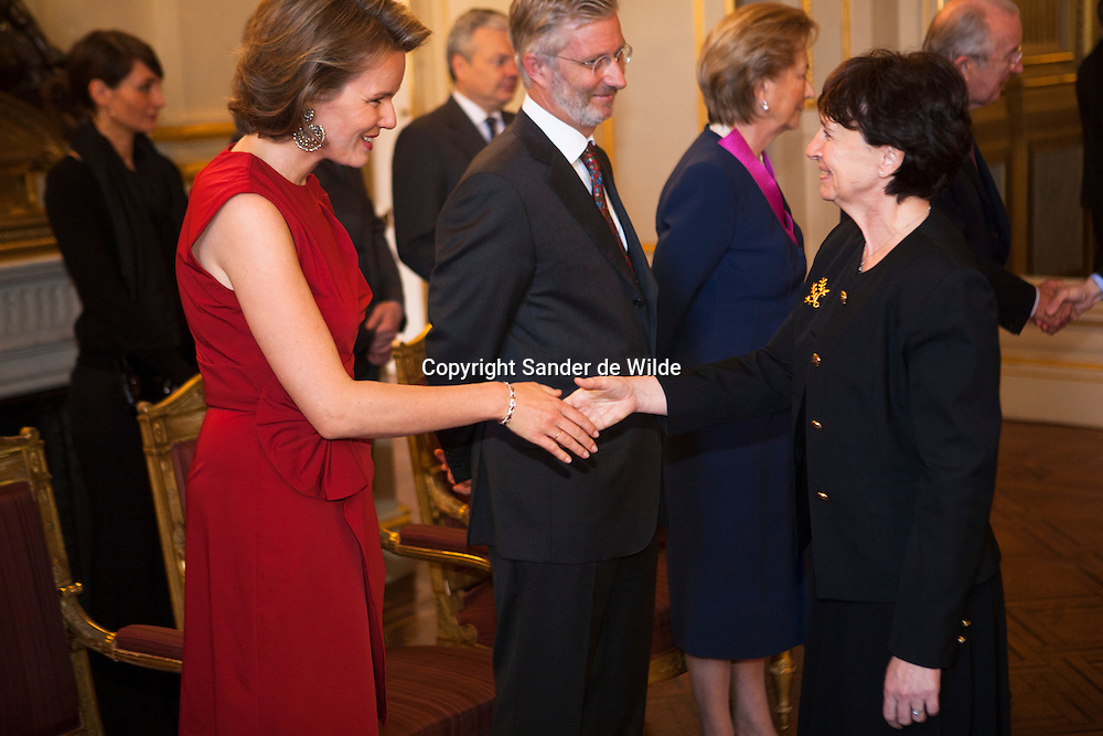 Princess Mathilde of Belgium shakes hands with French Ambassador Michele Boccoz during the New Year reception for the Diplomatic Heads of Mission at the Royal Palace on January 11, 2012 in Brussel, Belgium.