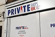 Signs outside licensed adult shop, UK