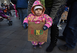 "December 10, 2016 - Washington, DC, USA - VIVIENNE BAKER, 19 months old, makes a sign. Children's Rally for Kindness takes place at Trump International Hotel in Washington DC on December 10, 2016 organized by the Takoma Parents Action Coalition.  According to their FaceBook page, it was a call to President-elect Donald Trump: ''to remember these lessons as he prepares to take office and implement policies that will affect the lives of children and families across our diverse nation.''.''All over the world, across cultures and countries, children learn the same basic lessons: .Ã'be kind,Ã"" .Ã'tell the truth,Ã"" .Ã'be fair,Ã"" .Ã'respect everyone,Ã"" .Ã'treat others the way you want to be treated,Ã"" .Ã'donÃ•t touch others if they donÃ•t want to be touched. (Credit Image: © Carol Guzy via ZUMA Wire)"