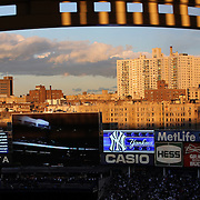 A view of buildings surrounding Yankee Stadium as the late evening sunshine catches the Yankee Stadium facade during the New York Yankees V Baltimore Orioles American League Division Series play-off decider at Yankee Stadium, The Bronx, New York. 12th October 2012. Photo Tim Clayton