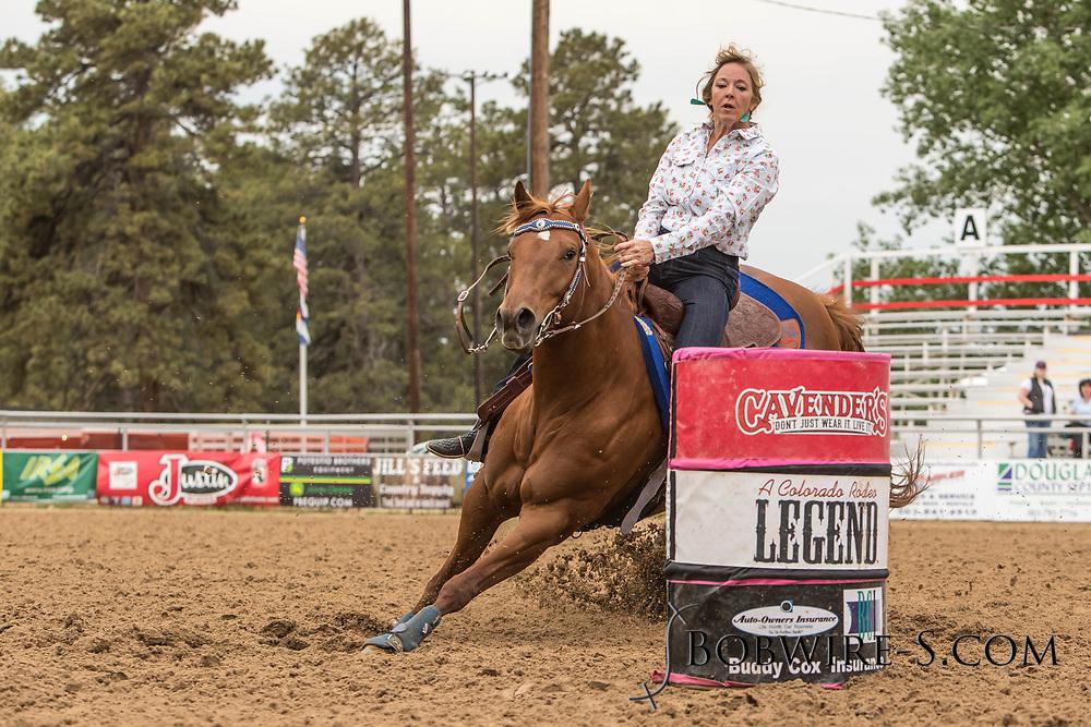 Lana Randall makes her barrel racing run during slack at the Elizabeth Stampede on Sunday, June 3, 2018.