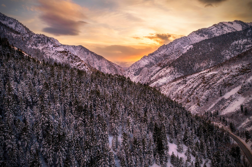 Looking down Big Cottonwood Canyon near Salt Lake City from above at sunset on a snowy Winter evening.