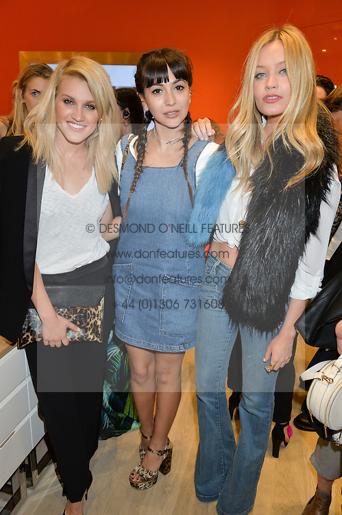 Left to right, ASHLEY ROBERTS, ROXIE NAFOUSI and LAURA WHITMORE at the launch the Folli Follie Flagship store at 493 Oxford Street, London on 28th May 2015.
