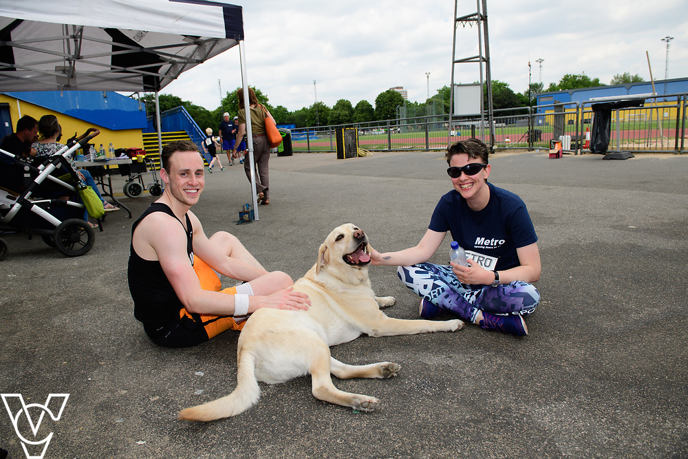 Metro Blind Sport's 2017 Athletics Open held at Mile End Stadium.  Athletes and guide runners with a guide dog.  Maya-Liam Haynes with guide runner<br /> <br /> Picture: Chris Vaughan Photography for Metro Blind Sport<br /> Date: June 17, 2017
