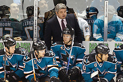 November 30, 2010; San Jose, CA, USA; San Jose Sharks head coach Todd McLellan on the bench behind his team during the first period against the Detroit Red Wings at HP Pavilion. Mandatory Credit: Jason O. Watson / US PRESSWIRE