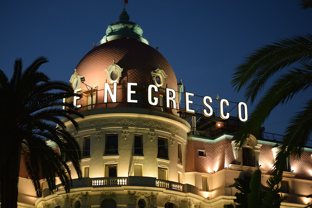 Negresco Hotel sign at Dusk on the promenade Des Anglais