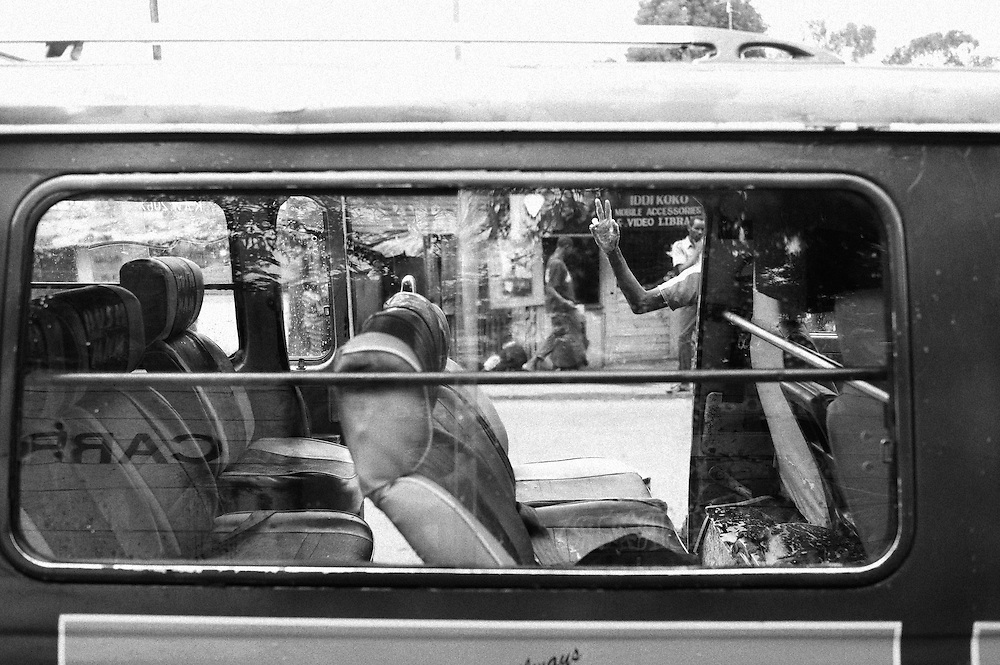 """NAIROBI, KENYA - AUGUST 17, 2011: Members of Carrribean Youth Reform wash Matatus off the main road into Kibera. Formerly called Caribbean Youth Group, the organization changed its name to Caribbean Youth Reform after several violent youth in the neighborhood came under their ranks and were """"reformed"""" under their leadership. Begun in 2008 as a result of the post-election violence, the group of youth operate with the goal of uniting the young people of differing tribes. With over 60 members, the group operates a car and carpet washing business as well as manages a weekly garbage collection project through which they clean up neighborhoods, gather manure for compost and sort plastics to sell for income. The group plans to soon build a community toilet and bathroom in the area where the work, and they are also organizing a conflict management and peacekeeping team. Income generated from their activities is consistent but minimal, says acting secretary Abdallah Juma, age 23. Juma says financial instability is the group's primary hurdle to progress. """"We are the founders of this country,"""" he said. """"Even without government intervention, we as youth can do it ourselves."""" The long term goal of the youth group is to see fewer youth unemployed.<br /> <br /> Various grassroots initiatives led by youth have begun to improve the quality of life for those living in the direst of conditions, and young people of different tribes are using gardening, waste removal, education and athletics to encourage their peers toward a self-respecting and self-sustaining community. Termed """"youth groups"""" on the street, these initiatives could represent the future of long-term socioeconomic development in Kenya while laying the groundwork for a more peaceful election in 2013. During the post-election violence of 2007 and 2008, impoverished youth in Kenya were routinely bribed by the nation's political elite to carry out acts of violence in their communities. Idleness among the youth, combined with t"""