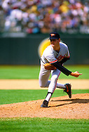 OAKLAND-1990: Gregg Olson pitches during an MLB game against the Oakland Athletics at the Coliseum in Oakland, California during the 1990 season.  Olson pitched for the Orioles from 1988-1993.  (Photo by Ron Vesely)