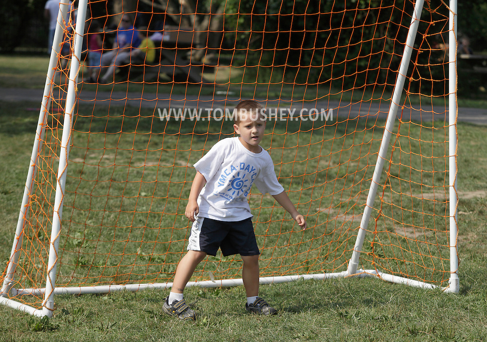 Middletown, New York - A boy stands in the goal during a soccer game at Middletown YMCA summer camp on August 20, 2010.