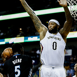Mar 19, 2017; New Orleans, LA, USA; New Orleans Pelicans forward DeMarcus Cousins (0) defends against Minnesota Timberwolves forward Gorgui Dieng (5) during the first quarter of a game at the Smoothie King Center. Mandatory Credit: Derick E. Hingle-USA TODAY Sports