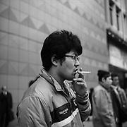 Shinjuku Smokers Tokyo by photojournalist Darren Clayton