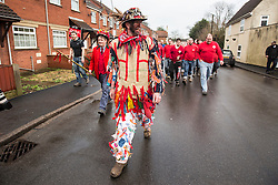 "© Licensed to London News Pictures. 06/01/2016. Haxey UK. Picture shows Dale Smith ""the fool"" leading the crowd at The Haxey Hood that takes place today, The historic event dating back to the 14th century sees teams representing four pubs in Haxey & Westwoodside compete for a leather cylinder known as the hood. After a pub crawl around the participating pubs, the game begins with a famous speech from the ceremonial fool. The game is won when the scrum reaches one of the pubs and the hood is touched by the landlord or landlady. Photo credit: Andrew McCaren/LNP"