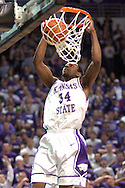 Kansas State's Akeem Wright slams the ball down, as the Wildcats charge back during the second half against Colorado.  The Wildcats defeated the Buffaloes 72-60 at Bramalage Coliseum in Manhattan, Kansas, February 18, 2006.