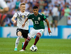 MOSCOW, RUSSIA - Sunday, June 17, 2018: Germany's Marco Reus (left) and Mexico's Jesus Gallardo (right) during the FIFA World Cup Russia 2018 Group F match between Germany and Mexico at the Luzhniki Stadium. (Pic by David Rawcliffe/Propaganda)