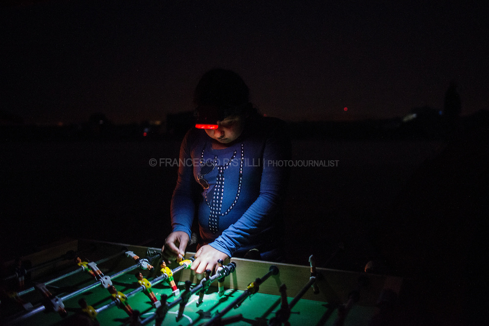 A Kurdish girl spends the night playing with a recycled table-football at Idomeni Refugee Camp, a makeshift camp on the Greek-Macedonian border where thousands of refugees are stranded.