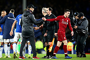 Liverpool Manager Jurgen Klopp shakes Liverpool defender Andrew Robertson (26) hand at the end of the Premier League match between Everton and Liverpool at Goodison Park, Liverpool, England on 3 March 2019.