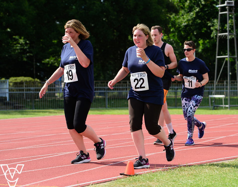 Metro Blind Sport's 2017 Athletics Open held at Mile End Stadium.  5000m.  From left, Competitor #19, Ruth Stacey and Maya-Liam Haynes with guide runner<br /> <br /> Picture: Chris Vaughan Photography for Metro Blind Sport<br /> Date: June 17, 2017