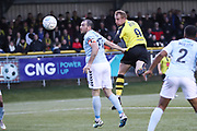 Harrogate Town forward Mark Beck (9) heads goalward under pressure from Braintree Town defender Joe Ellul (17)  during the Vanarama National League match between FC Halifax Town and Dover Athletic at the Shay, Halifax, United Kingdom on 17 November 2018.