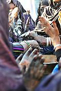 """Tuareg women playing the """"tinde"""" drum in Tamanrasset, Algeria. 2011"""