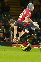 Rugby Union - 2016 / 2017 Pro12 - [Judgement Day V]: Newport Gwent Dragons vs. Scarlets<br /> <br /> Jonathan Davies of Llanelli Scarlets  passes the ball inside , at Principality Stadium [Millennium Stadium], Cardiff.<br /> <br /> COLORSPORT/WINSTON BYNORTH