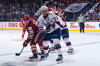 REGINA, SK - MAY 27: Samuel Asselin #28 of Acadie-Bathurst Titan is checked by Sam Steel #23 of Regina Pats after a first period face off at the Brandt Centre on May 27, 2018 in Regina, Canada. (Photo by Marissa Baecker/CHL Images)