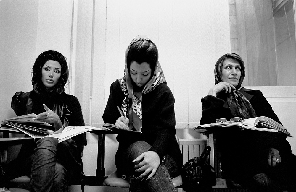Two Iranian beauticians and a house wife are following English lessons in class. Tehran, Iran, 2007