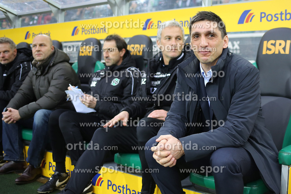 15.03.2015, Borussia Park, Moenchengladbach, GER, 1. FBL, Borussia Moenchengladbach vs Hannover 96, 25. Runde, im Bild Trainer Tayfun Korkut (Hannover 96) auf der Ersatzbank // 15054000 during the German Bundesliga 25th round match between Borussia Moenchengladbach and Hannover 96 at the Borussia Park in Moenchengladbach, Germany on 2015/03/15. EXPA Pictures &copy; 2015, PhotoCredit: EXPA/ Eibner-Pressefoto/ Schueler<br /> <br /> *****ATTENTION - OUT of GER*****