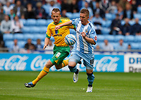 Photo: Richard Lane/Richard Lane Photography. Coventry City v Norwich City. Coca-Cola Championship. 09/08/2008. Coventry's Freddie Eastwood (rt) is challenged by Norwich's Sammy Clingan.