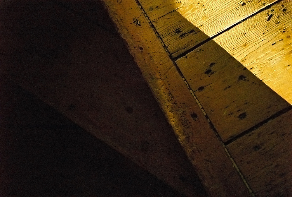 Top of wooden staircase in partial sunlight
