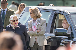© Licensed to London News Pictures. 11/05/2018. Windsor, UK. Queen Elizabeth II watches the competition as the Duke of Edinburgh remains in a car (R) during the 75th Royal Windsor Horse Show. This is the first time that the Duke has been seen in public since his hip operation last month. The five day event takes place in the grounds of Windsor Castle. Photo credit: Peter Macdiarmid/LNP