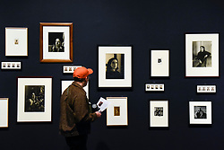 © Licensed to London News Pictures. 19/11/2019. LONDON, UK. A visitor views portraits of and by Dora Maar. Preview of the first UK retrospective of Dora Maar (born Henriette Theodora Markovitch, 1907-97) whose photographs and photomontages became celebrated icons of surrealism.  Over 200 of her works are on display in a career spanning more than six decades at Tate Modern 20 November to 15 March 2020.  Photo credit: Stephen Chung/LNP