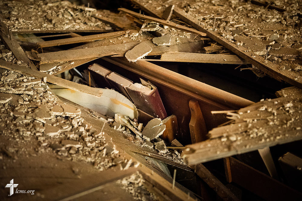Lutheran Service Books lay in damaged pews in the sanctuary of Immanuel Lutheran Church, St. Charles, Mo., on Monday, June 4, 2018. The entire baptismal side of the sanctuary interior ceiling collapsed May 29 at 1.29 a.m. in the morning. No one was injured in the collapse. LCMS Communications/Erik M. Lunsford