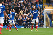 Portsmouth defender Christian Burgess (6) is congratulated after his goal to make it 1-1 during the EFL Sky Bet League 2 match between Portsmouth and Wycombe Wanderers at Fratton Park, Portsmouth, England on 10 September 2016. Photo by David Charbit.