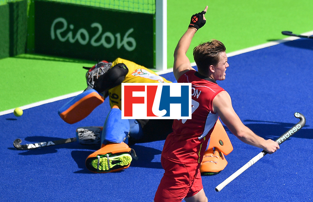 Belgium's Tom Boon (R) celebrates his team's goal during the men's quarterfinal field hockey Belgium vs India match of the Rio 2016 Olympics Games at the Olympic Hockey Centre in Rio de Janeiro on August 14, 2016. / AFP / Carl DE SOUZA        (Photo credit should read CARL DE SOUZA/AFP/Getty Images)