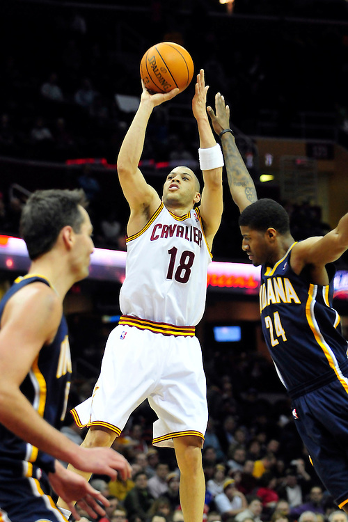Feb. 2, 2011; Cleveland, OH, USA; Cleveland Cavaliers shooting guard Anthony Parker (18) shoots over Indiana Pacers small forward Paul George (24) during the second quarter at Quicken Loans Arena. Mandatory Credit: Jason Miller-US PRESSWIRE