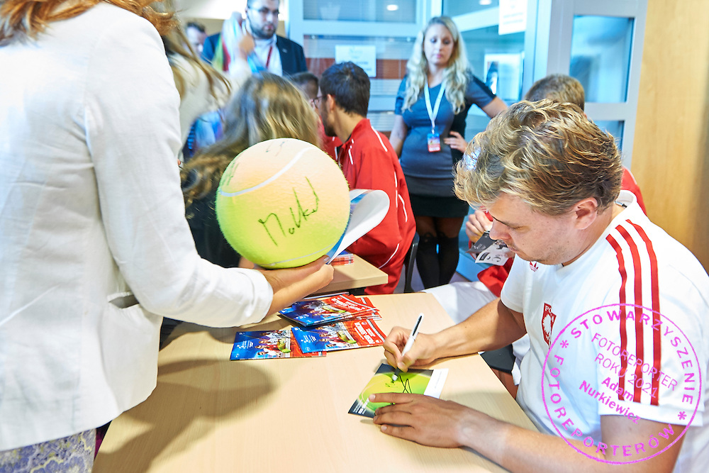 Marcin Matkowski from Poland while autographs session during Davis Cup Tie World Group Play-off Poland v Slovakia at Gdynia Arena Hall in Gdynia, Poland.<br /> <br /> Poland, Gdynia, September 19, 2015<br /> <br /> Picture also available in RAW (NEF) or TIFF format on special request.<br /> <br /> For editorial use only. Any commercial or promotional use requires permission.<br /> <br /> Adam Nurkiewicz declares that he has no rights to the image of people at the photographs of his authorship.<br /> <br /> Mandatory credit:<br /> Photo by &copy; Adam Nurkiewicz / Mediasport